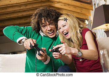 domestic life - multiethnic couple having fun with a new...