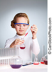 School laboratory - Female pupil mixing substances in the...