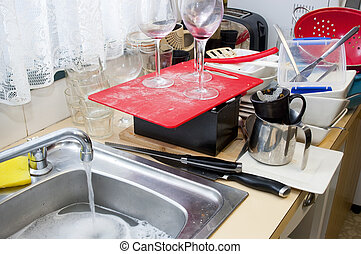 Cleaning Dishes - Cleaning up dirty dishes at home on the...