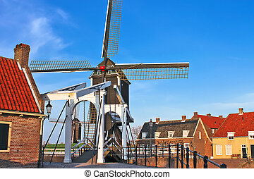 Bascule bridge and windmill at sunset Heusden Netherlands