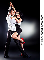 latin dance - Beautiful couple of professional artists...