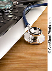 stethoscope and magnifying glass on keyboard - medical...