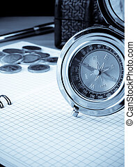 compass, gold coin and pen on notebook - compass, gold coin...