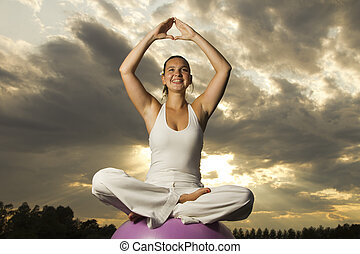 Young brunette girl performing yoga - Young attractive...