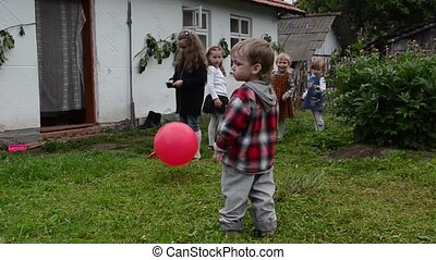 children playing - small children playing with a ball near...