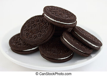 Oreo cookies on a white saucer dish - some Oreo chocolate...