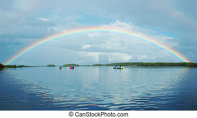 Kayaking in Polar Karelia with rainbow ,Engozero lake - one...