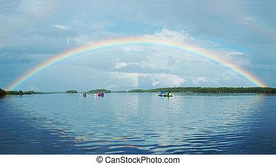 Kayaking in Polar Karelia with rainbow ,Engozero lake - one...