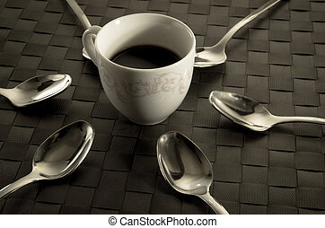 Coffee and teaspoons still life