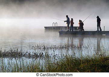Morning Lake Mist - Early morning fishing in autumn on a...