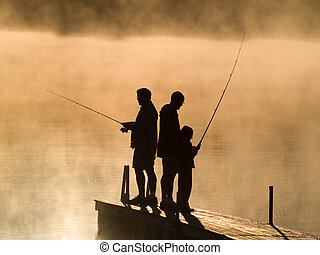 Fishing - Family fishing on an early autumn morning on a...