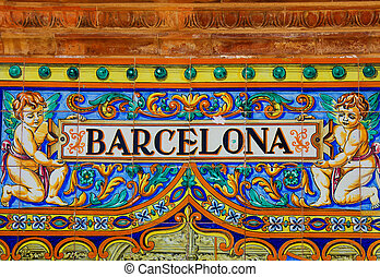 Barcelona sign over a mosaic wall - Famous ceramic...