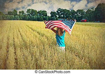 Girl running with flag - Young girl running with American...