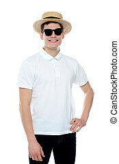 Man smiling with hand on his waist wearing hat