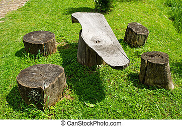 Table and chairs of wood trunk stumps Rest place - Table and...