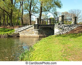 bridge in park - bridge in a pretty park in spring on...