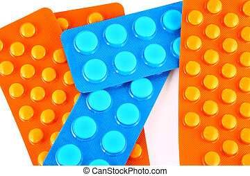 blue and orange tablets - Tablets and vitamin pills in...