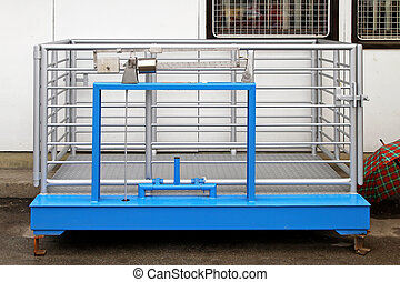 Livestock scale with cage for hogs and sheeps