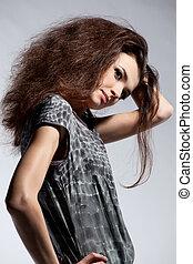 Portrait of fashion woman in dress