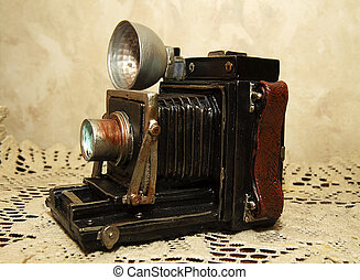 Antique Camera Replica - Replica of antique camera on lace