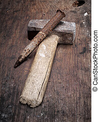 Hammer and chisel - Old used hammer and chisel on a wooden...