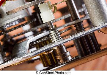Gear Mechanism - Close-up photograph of a silver gear...