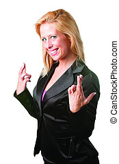 Businesswoman crossing her fingers isolated in a white...