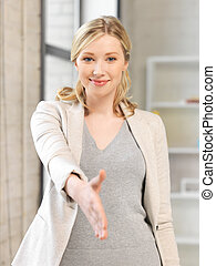 woman with an open hand ready for handshake - lovely woman...