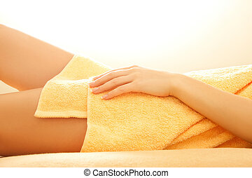 female hands and legs in spa salon