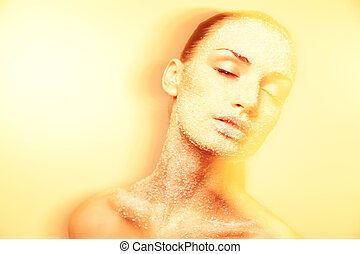 Mystical young woman with creative golden makeup - Luxurious...