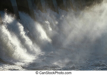 Hydro Dam Spillway - The sun dramatically backlighting the...