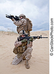 fighting - two US marines aim at different directions...