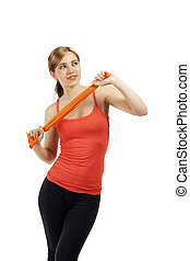 beautiful young fitness woman train with a orange ribbon on white background