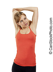 young smiling fitness woman stretching her arms on white background