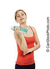 beautiful fitness woman with a bottle of water on white background