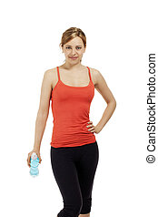young fitness woman with a bottle of water on white background