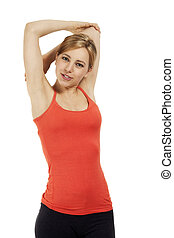 young beautiful fitness woman stretching her arms on white background