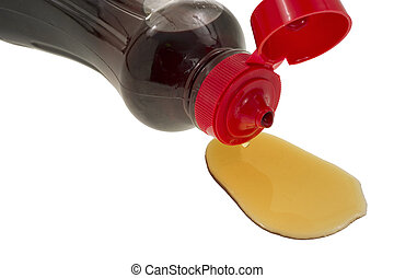 Close view syrup spilling from container