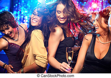 Party time - Cheerful girls living it up on the dance floor