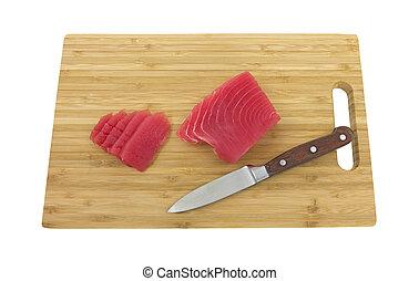 Tuna on wood cutting board