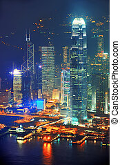 Hong Kong aerial night - Victoria Harbor aerial view with...