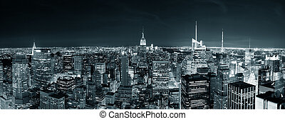 New York City Manhattan skyline at night panorama black and...