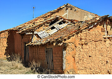 mud houses in ruins of an abandoned village