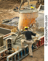 Construction worker pouring concrete - Construction worker...