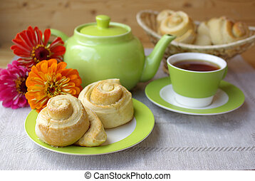 Tea party and buns - Tea with buns on the gray cloth