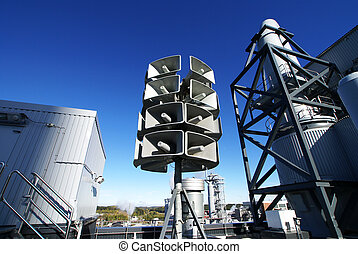 industrial loudspeakers with a natural blue background
