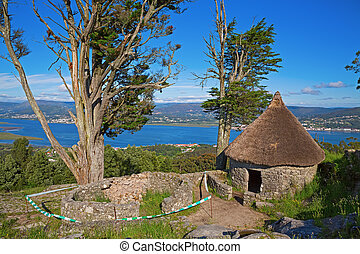 Rebuilt Celtic shack - Reconstructed Celtic shack and ruined...