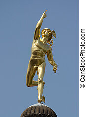 Mercury Statue with blue sky.