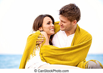 Couple on the Beach Looking at Each Other - Portrait of an...