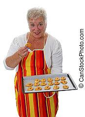 Female senior with cookies